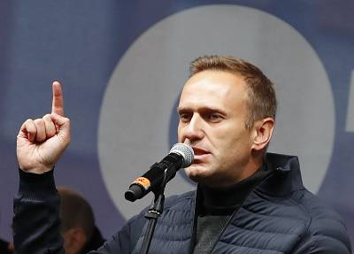 Russian opposition leader Alexei Navalny speaks during a rally to support political prisoners in Moscow, Russia, Sunday, Sept. 29, 2019.
