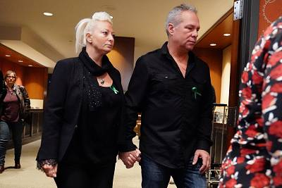 Charlotte Charles and her husband, Bruce Charles, arrive for a news conference in New York on Monday.