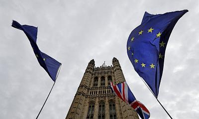 A European Union flag flies near Parliament in London.