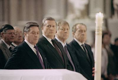 Yankee\'s owner George Steinbrenner, center, and former President Richard Nixon, end right, attend the funeral of Billy Martin at St. Patrick\'s Cathedral in New York, Dec. 29, 1989.