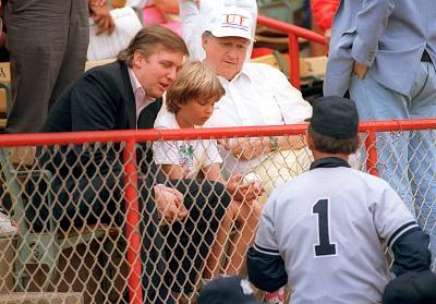 Donald Trump meets New York Yankees manager Billy Martin, right, at Municipal Stadium in West Palm Beach on March 26, 1988. Seated with Trump are his son Donald, 10, with a ball given him by Martin and Yankees owner George Steinbrenner during the game with the Montreal Expos.