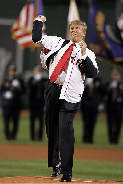Donald Trump throws the first pitch before the start of the second game of an American League double header between the Boston Red Sox and New York Yankees at Fenway Park in Boston on Aug. 18, 2006.
