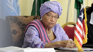 Liberia's Sirleaf promises face-off with her party over expulsion