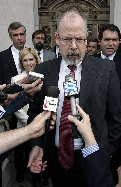 John Durham speaks to reporters on the steps of U.S. District Court in New Haven, Conn on April 25, 2006.