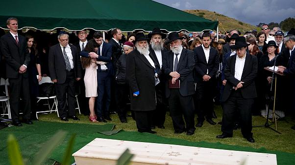 Image: Hannah Kaye, along with Jewish community leaders and mourners, stand