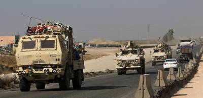 A convoy of U.S. vehicles at the Iraqi-Syrian border crossing in the outskirts of Dohuk, Iraq, on Monday.