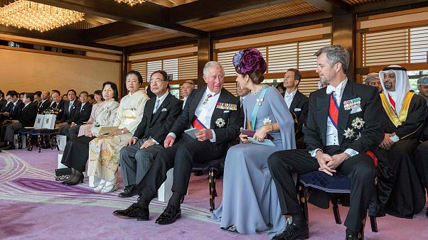 Image: Britain's Prince Charles chatting with Denmark's Crown Princess Mary