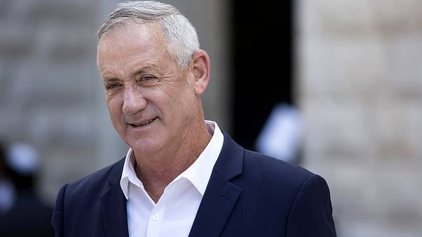 Image: Blue and White Party leader Benny Gantz leaves after paying tribute