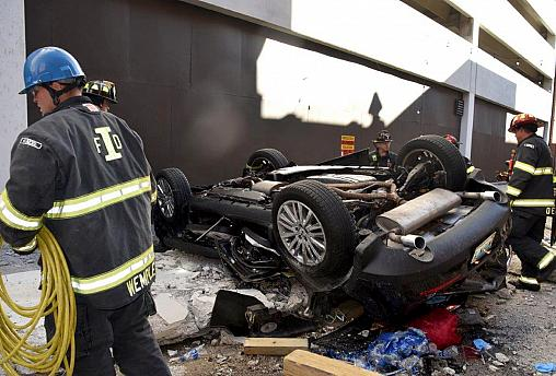 Image: Two people are dead after a car drove off a 4th floor parking garage