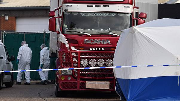 Image: Police officers in a forsensic suits at the scene of a lorry found t