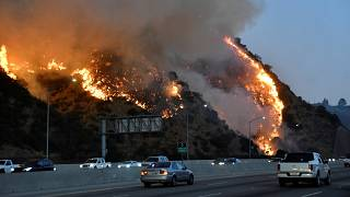 Image: The Getty fire burns near the Getty Center along the 405 freeway nor