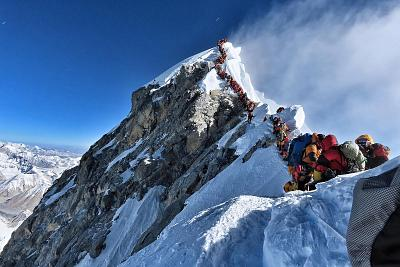 Purja\'s photo showing heavy traffic at the summit of Mount Everest.