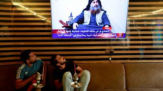 Image: Iraqi youth watch the news of Islamic State leader Abu Bakr al-Baghd