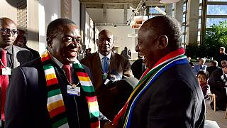 Ramaphosa, Mnangagwa bedazzle Davos delegates with 'national' scarves