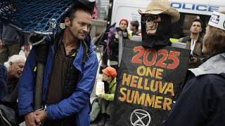 Image: Climate protesters block Millbank in central London
