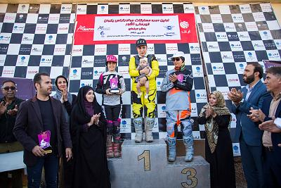 Jabbari holds her infant daughter, Hanna, before receiving the gold medal at the Iranian Women\'s Motocross Championship in Tehran on Oct. 11, 2019.