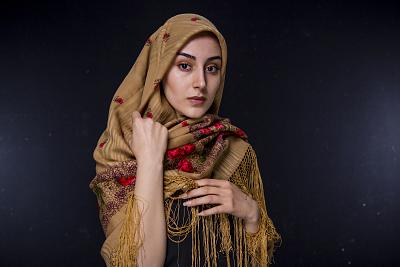 Azadeh Seifi poses Jan. 8, 2019, in front of a mirror, which she often does to prepare herself for the camera. It is a ritual that helps her become more familiar with her facial expressions and improves her acting, she says.