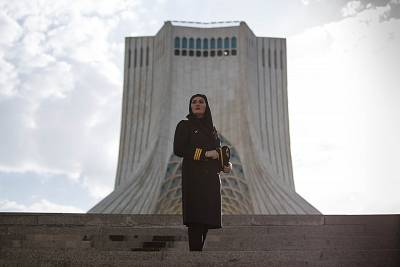 Dastjerdi stands in front of Tehran\'s Azadi Tower, a symbol of freedom June 1, 2017. She asked to be pictured in this spot, saying women in Iran should fight for their rights and their freedom.