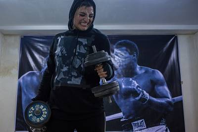 Sadaf Khadem lifts weights at her gym in Varamin, a small town outside Tehran on Jan. 4, 2017.