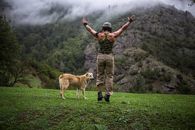 Sabour, who trains every day no matter where she is, does her morning exercise routine Sept. 22, 2014, while traveling with a friend in Talesh, in northern Iran.