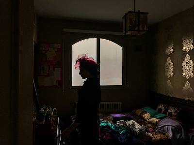 Azadeh Seifi prepares for a photo shoot March 8, 2015.