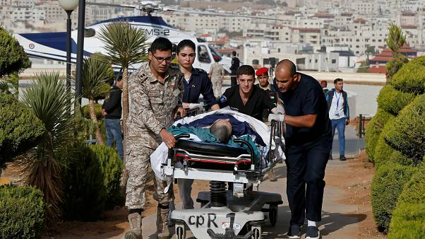 Image: Tourist, who was injured in a stabbing, is brought into King Hussein