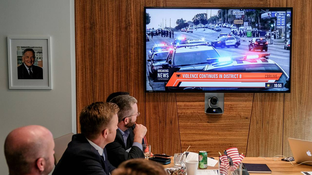 Images of an immersive simulation of mock news events are displayed during
