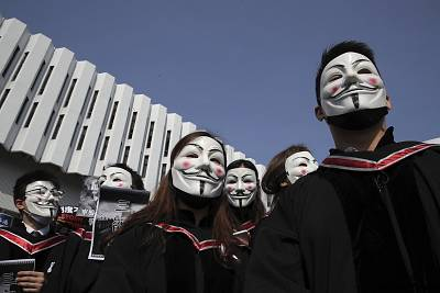 University students wearing Guy Fawkes masks during a protest before their graduation ceremony at the Chinese University of Hong Kong on Thursday.