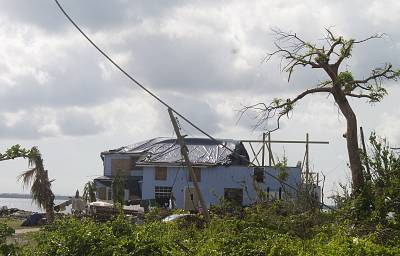 About 500 people live on Green Turtle Cay and, with nearly half of the barrier island\'s structures flattened by Hurricane Dorian, they are now sharing whatever dry housing remains.