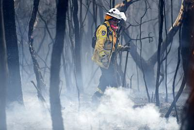 A NSW RFS firefighter undertakes mopping up at South Turramurra on Nov. 12, 2019 in Sydney, Australia