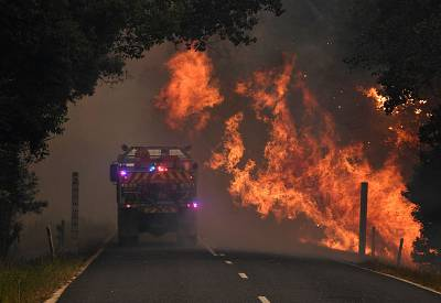 A fire truck near a bushfire in Nana Glen, near Coffs Harbour, Australia, Nov. 12, 2019.