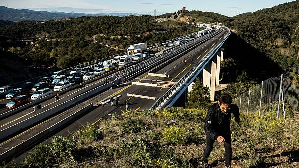 Image: Separatist Catalonian protesters block the border between France and