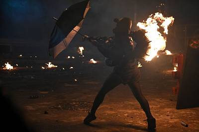 A protester\'s backpack is seen on fire during clashes with police at the Chinese University of Hong Kong (CUHK), in Hong Kong on Nov. 12, 2019.