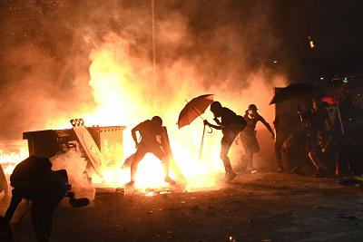 Protesters set up a fire during clashes with police at the Chinese University of Hong Kong (CUHK), in Hong Kong on Nov. 12, 2019.