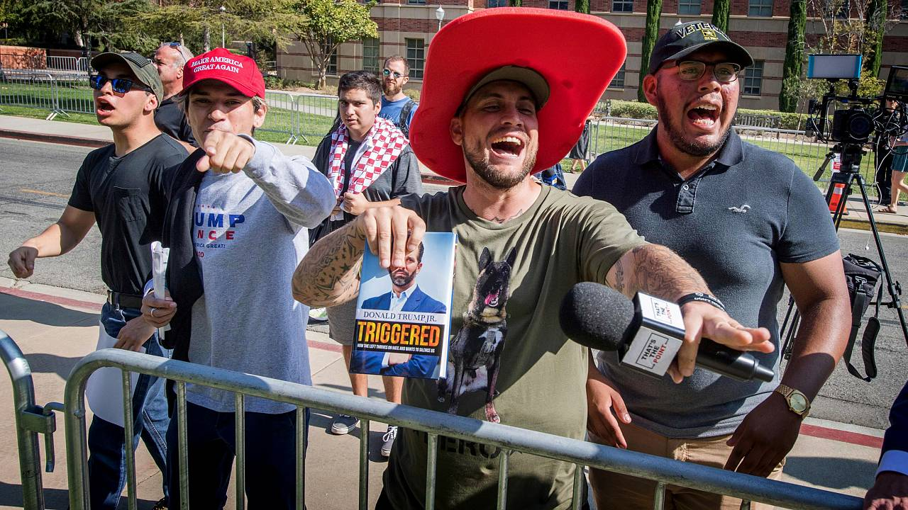 Image: Supporters of President Donald Trump yell at counter protesters outs