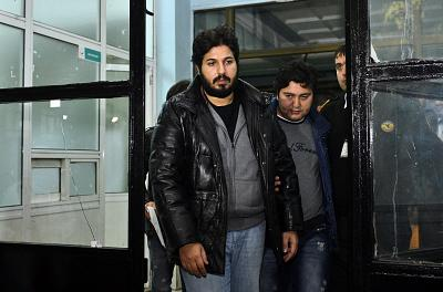 Reza Zarrab is taken to police headquarters in Istanbul on Dec. 17, 2013.