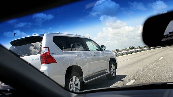 Image: A SUV travels on a highway in Sunrise, Fla., in 2010.