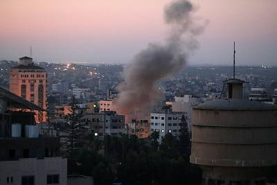Smoke rises following an explosion in Gaza City on Tuesday.