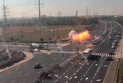 CCTV footage shows an explosion on a highway near Ashdod, Israel, on Tuesday.
