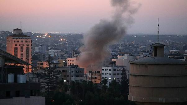 Image: Smoke rises following an explosion in Gaza City