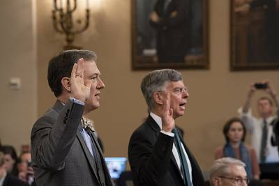 George Kent, left, and William Taylor are sworn in to testify before the House Intelligence Committee on Wednesday.