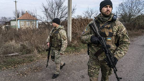 Image: Ukrainian policemen patrol a street near the new line of contact in