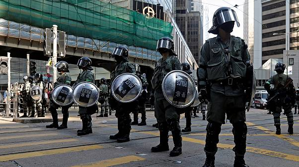 Image: Riot police stand in the middle of a street in Central district in H