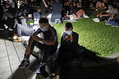 Extradition law protesters browse their smartphones near the Legislative Council in Hong Kong. Encrypted messaging app Telegram said Thursday that it was hit by a powerful cyberattack from China while massive protests were unfolding in Hong Kong.