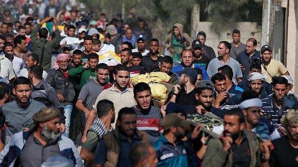 Image: Palestinians attend the funeral procession of members of the same fa