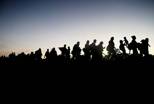 Image: A migrant caravan walks towards the United States in Tapanatepec, Me