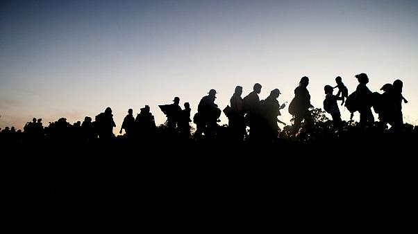 Image: A migrant caravan walks towards the United States in Tapanatepec, Me