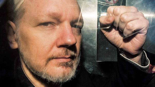 Image: WikiLeaks founder Julian Assange gestures from the window of a priso