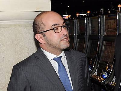 Yorgen Fenech of the Tumas Group talks with VIP guests during the opening of the Oracle Casino in St Paul\'s Bay, Malta, June 4, 2014.