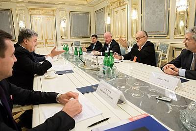 Rudy Giuliani at a meeting with former Ukraine President Poroshenko, and Vitaly Pruss sitting at the end of the table to Giuliani\'s far right, on Nov. 22, 2017.
